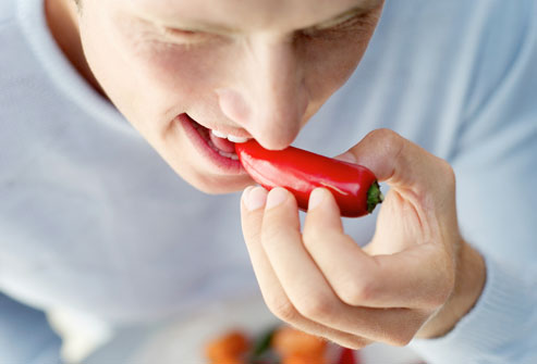 getty_rf_photo_of_man_eating_hot_pepper